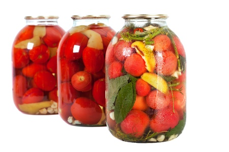 Preserved red tomatoes in a glass jar isolated on white background Stock Photo - 10767747
