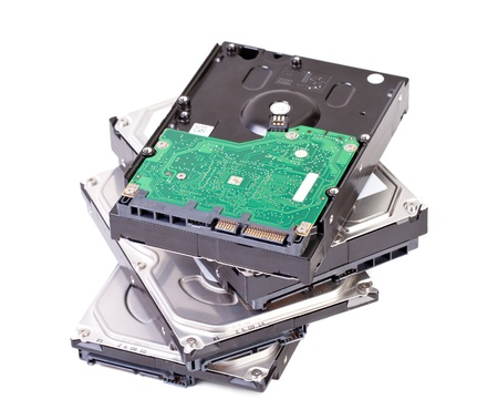 Close up of hard disk drive isolated on white background photo