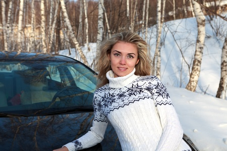 Young woman near the car in Winter forest Stock Photo - 13666172