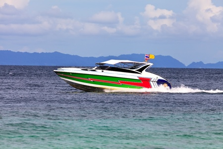 glide: Colorful speed boat glide on sea waves  Stock Photo