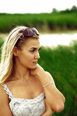 Portrait of beautiful caucasian woman on nature, cane field photo