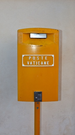 Orange Vatican post box on Saint Peter Square. Rome. Italy. photo