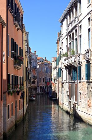 One of narrow canal in Venice. Italy. Europe. photo