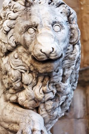 stone carving: Llion near Palazzo Vecchio in Florence. Italy. Europe.