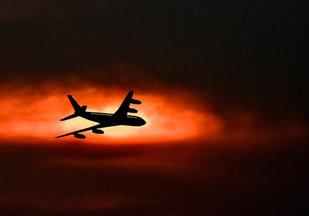 jet airplane: Passenger jet airplane silhouette in blurred sunset sky. Vector illustration.