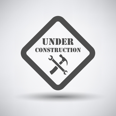 under construction icon: Under construction icon on gray background with round shadow.