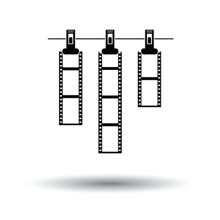film title: Icon of photo film drying on rope with clothespin. White background with shadow design. Vector illustration.
