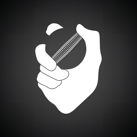 Hand holding cricket ball icon. Black background with white. Vector illustration.