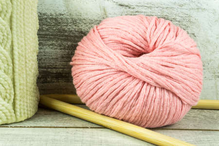 warm cloth: Colored wool ball with needles and a candle with knitted pattern