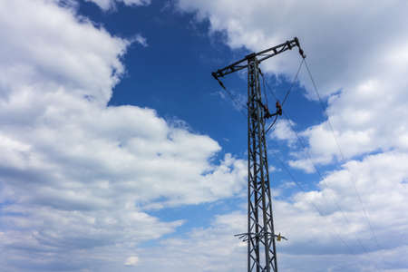 Electricity mast with blue sky and clouds at sunshine