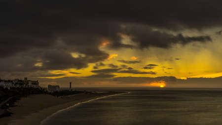 Coast of Jandia Fuerteventura at sunset and dark clouds Stock Photo