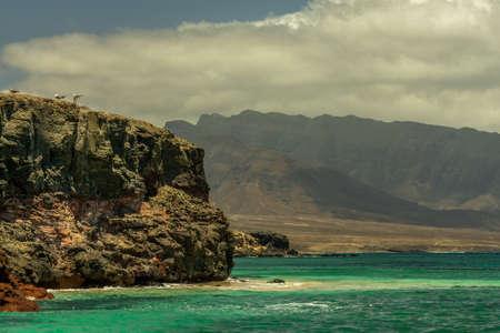 Wild and rugged volcanic coast near Punta Jandia, Fuerteventura, Canary Islands