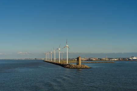 Wind turbines near a harbor in the industrial area of Zeebrugge Stockfoto