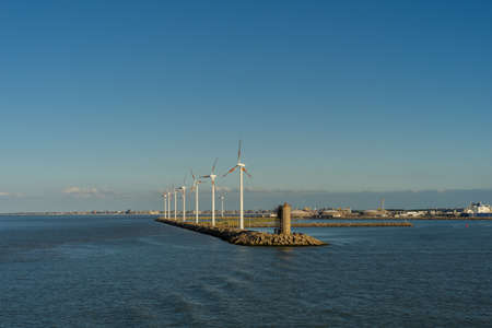 Wind turbines near a harbor in the industrial area of ​​Zeebrugge Imagens
