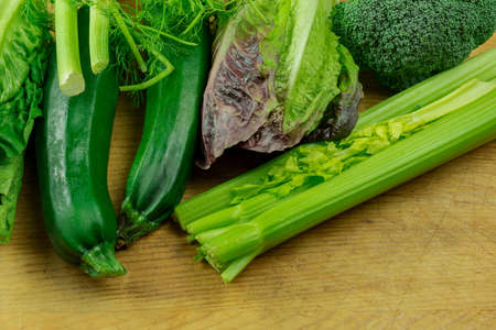 Delicacy green vegetables - fennel, zucchini, salad and broccoli. Useful vegetables on a wood board Stock fotó