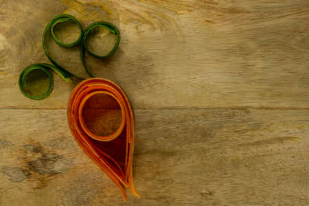 a compound carrot of cucumber and carrot on a wooden board Reklamní fotografie