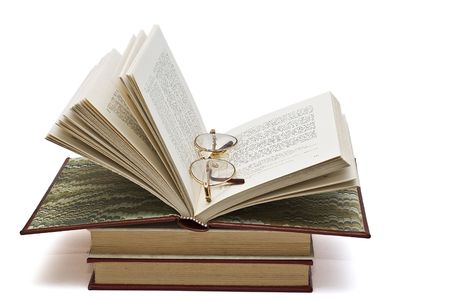 prose: Glasses on an open book.