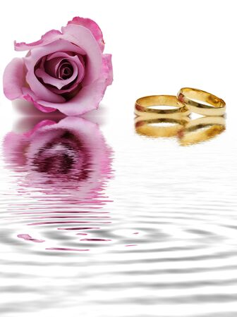 Rings and reflected rose. photo