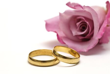 alliances: Wedding rings an a rose. Stock Photo