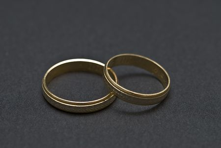 Two wedding rings on a black background. photo