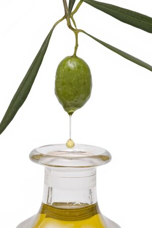 oil mill: One olive and a drop of oil falling into a bottle.