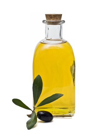 artisanal: A bottle of olive oil and one olive. Stock Photo