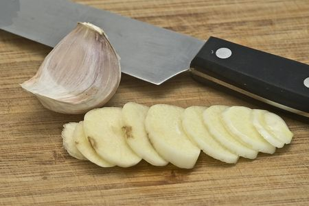Cutting garlic on the table. photo