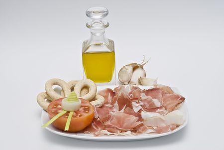 jamones: Un try con mermelada, tomate y aceite de oliva.