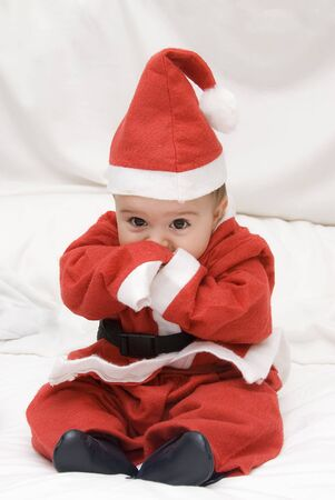 christmas costume: A very young Santa Claus.