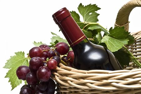 A bottle of wine and some grapes. Stock Photo - 7711358