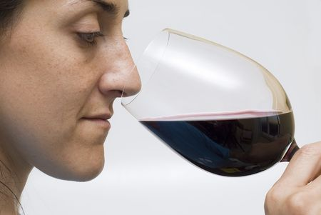 A sommelier tasting a cup of wine. photo