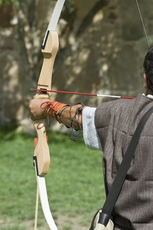 crossbow: An archer shooting.