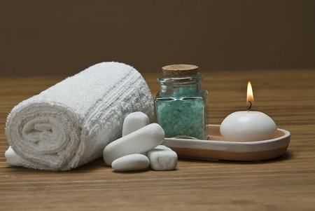Spa background with bath salts and a candle. photo