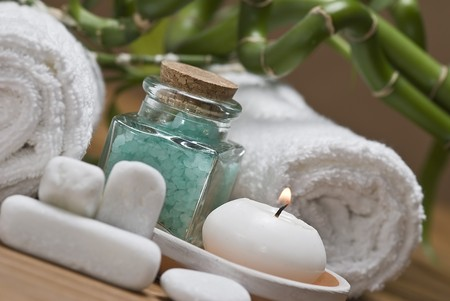heal care: Spa background with bath salts and a candle.