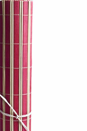 A red bamboo mat on a white background. photo