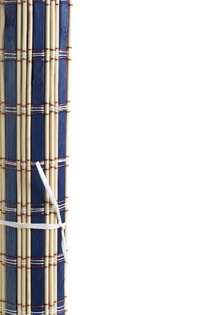 A blue bamboo mat on a white background. Stock Photo - 8096352