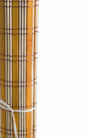 A yellow bamboo mat on a white background. photo