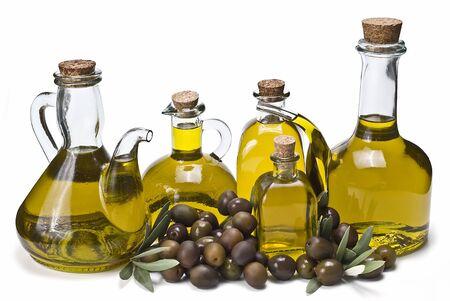 Bottles of olive oil and some olives.