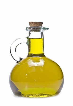 olive leaves: A cruet with olive oil on a white background. Stock Photo