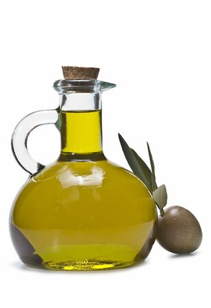 cruet: A cruet with olive oil on a white background. Stock Photo
