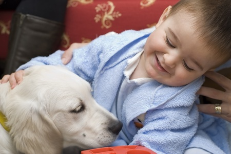 A little child playing with his pet. photo