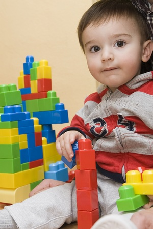 A child playing with a construction kit. photo