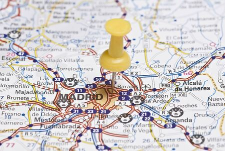 A pin on a roads map. photo