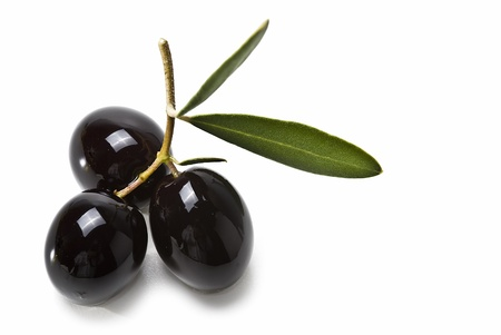 extra: Black olives isolated on a white background. Stock Photo