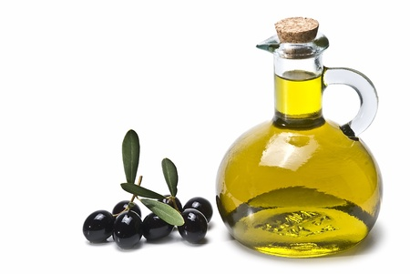 A bottle of olive oil and some olives isolated on a white background. Stock Photo - 8759347