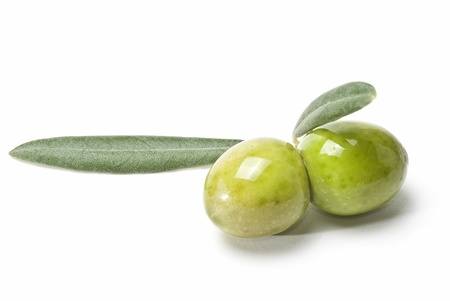 geen: A pair of geen olives isolated on a white background. Stock Photo