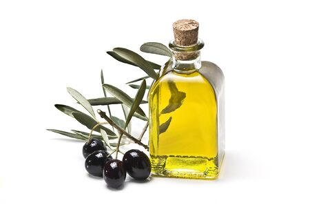 black  olive: A bottle of olive oil and some olives isolated on a white background. Stock Photo