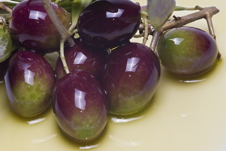 Closeup from some olives on olive oil. Stock Photo - 8759437