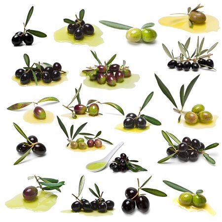 green olives: A collection of black and green olives isolated on a white background. Stock Photo