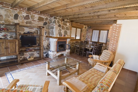 warmly: Living room with fireplace in a country cottage.